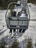 A vintage chair lift to take you to the top of the mountain. royalty free stock photo