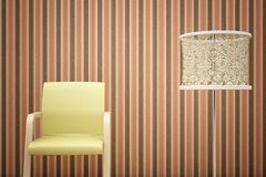 Chair, lamp and striped wallpaper Royalty Free Stock Image