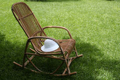 Chair and lawn. Rest in the shade Royalty Free Stock Photography