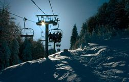 Chair Lift. Transporting skiers to the slopes stock photos