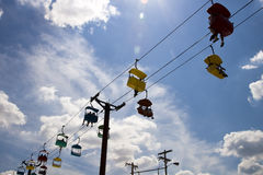 Chair Lift. People on a chairlift with a blue sky as the background Royalty Free Stock Photos
