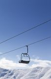 Chair lift against blue sky Stock Photos