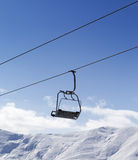 Chair lift against blue sky Stock Photography