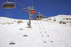 Chair lift in alps in full sun Royalty Free Stock Photo