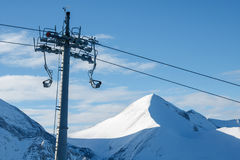 Chair lift on a background of mountains and sky Royalty Free Stock Image