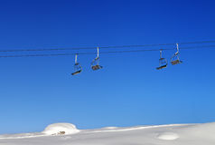 Chair-lift and blue clear sky at sunny day Stock Photography