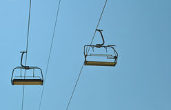Chair lift and blue sky Royalty Free Stock Photography