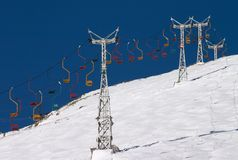 Chair lift in blue sky Stock Photography