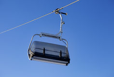 Chair-lift and blue sky Royalty Free Stock Images