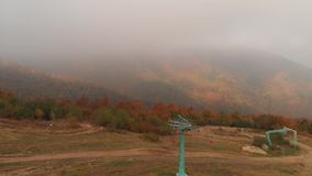 Chair lift in the Carpathian Mountains. Man Holds Bicycle. Chair lift in the Carpathian Mountains. Autumn forest. Man Holds Bicycle. Autumn in the Carpathian stock video footage