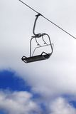 Chair-lift and cloudy sky Royalty Free Stock Photo