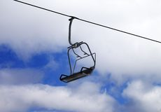 Chair-lift and cloudy sky Stock Photography