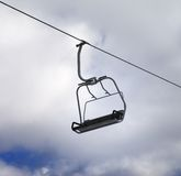 Chair-lift and cloudy sky Stock Photo