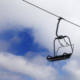 Chair-lift and cloudy sky Stock Images