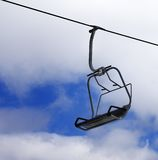 Chair-lift and cloudy sky Royalty Free Stock Images
