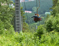 Chair lift couple hikers Royalty Free Stock Photography