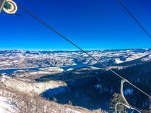 Chair lift and deer creek reservoire Royalty Free Stock Photos