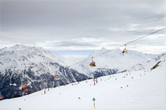 The chair lift on european mountain resort Stock Image