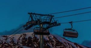 Chair Lift Evening Timelapse 4k. Evening timelapse of a still standing ski lift stock video footage