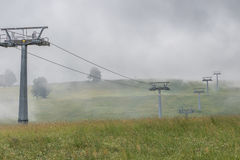 Chair Lift With Fog Stock Photography