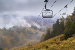 Chair lift in foggy mountain Royalty Free Stock Photography