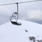 Chair lift and gray sky at evening Stock Photo