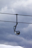 Chair lift at gray windy day Stock Photo