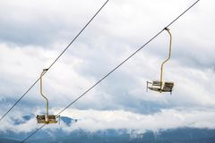 The chair lift highly in winter mountains Stock Images