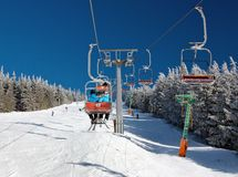 Chair lift on Mount Serak for downhill skiers Royalty Free Stock Images