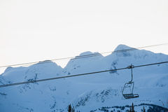 Chair lift and mountains Royalty Free Stock Photography