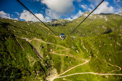 Chair lift in the mountains Stock Photos