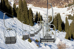 Chair lift in the mountains ski resort Stock Photos