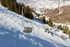 Chair lift in the mountains ski resort Royalty Free Stock Photo