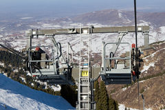 Chair lift in the mountains ski resort Royalty Free Stock Photos