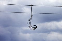 Chair-lift and overcast gray sky Royalty Free Stock Images