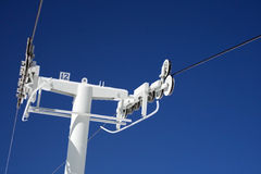 Chair Lift Pole. The top of chairlift pole #12 on a spectacular summer day Royalty Free Stock Photos