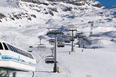 Chair lift on ski resort. Ski lift station and a chair lift on ski resort in Italy royalty free stock photos