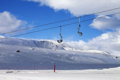 Chair-lift at ski resort Royalty Free Stock Image