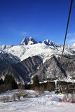 Chair-lift at ski resort and Mount Ushba in sun day Stock Images