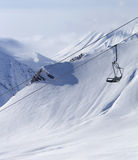 Chair lift at ski resort and off piste slope Royalty Free Stock Photo