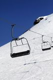 Chair-lift in ski resort at sun day Stock Images
