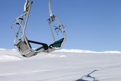 Chair-lift in ski resort at sun day after snowfall Stock Photography