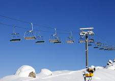 Chair-lift at ski resort at sun day after snowfall Royalty Free Stock Image