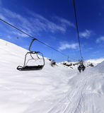 Chair-lift at ski resort in sun winter day Royalty Free Stock Photo