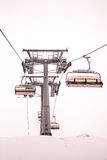 Chair lift at ski resort Zell Am See, Kaprun in Austria. Close up of chair lift at ski resort foggy day Stock Images