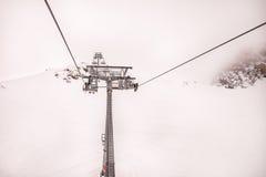Chair lift at ski resort Zell Am See, Kaprun in Austria. Chair lift at ski resort foggy day Stock Photos