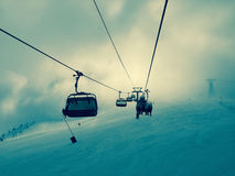 Chair lift on ski slopes Royalty Free Stock Photography