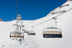 Chair lift and skiers Stock Images