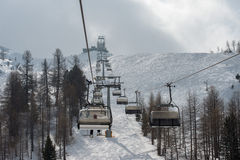 Chair Lift for skiers in winter snow Royalty Free Stock Photography