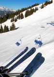 Chair lift and skis on snow Stock Photo